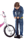 Young girl inflate wheel her bike — Stock Photo