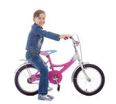 Young girl sitting on her bike — Stock Photo