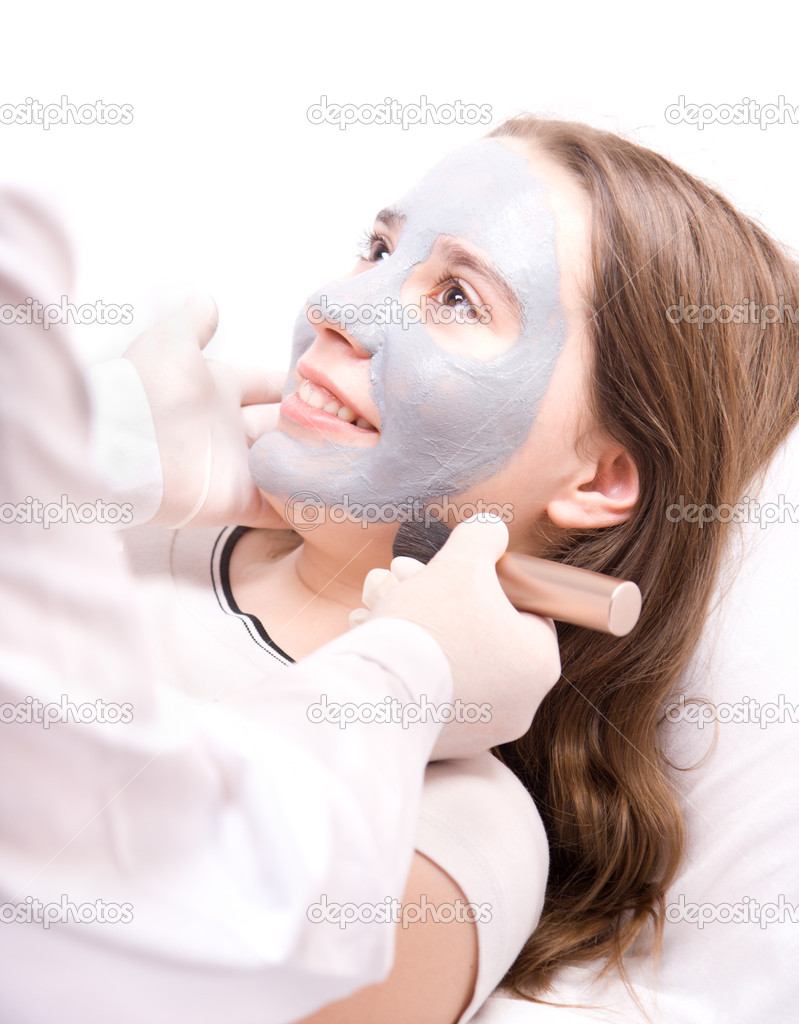 Beautician applying a clay face mask — Stock Photo ...