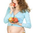 Pregnant women with apples — Stock Photo #2555144