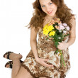 Smiling pregnant brunette with flowers - Stock Photo