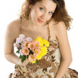 Smiling pregnant brunette with flowers — Stock Photo #2555176