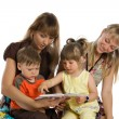 Two mothers read books to their children — Stock Photo
