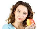 Young women with apple — Stock Photo