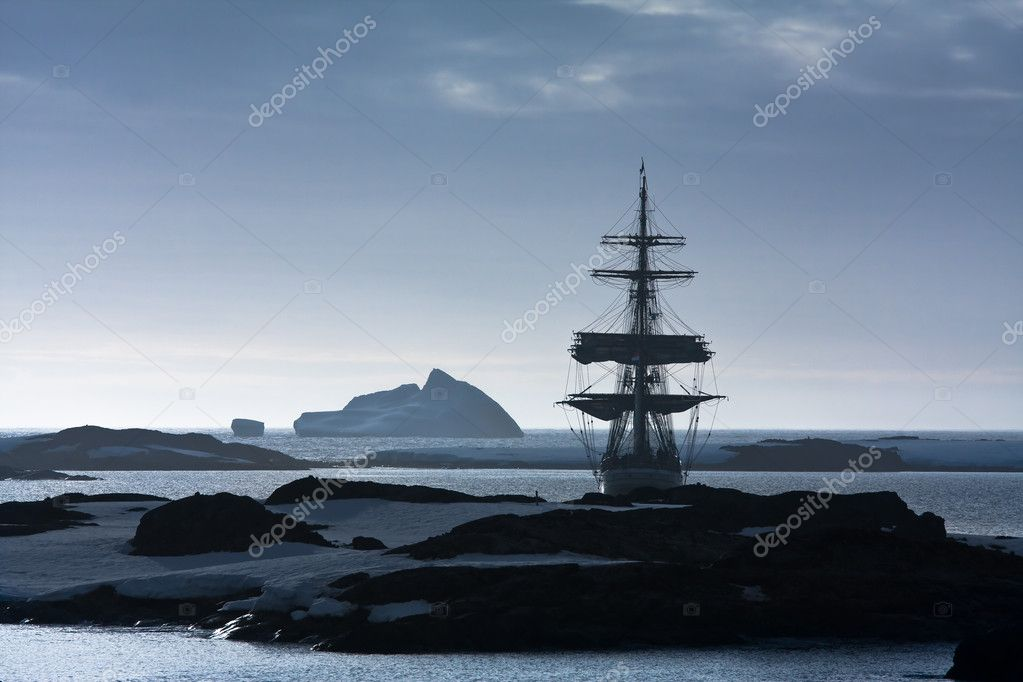 Sailing ship at dawn among the icebergs in Antarctica  Stock Photo #1644272