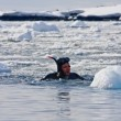 Diver near the ice — Stock Photo