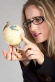 The girl has control over the globe — Stock Photo