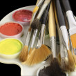 Stock Photo: Set of art brushes and water colour