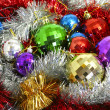 Multi-coloured tinsel and Christmas — Stock Photo