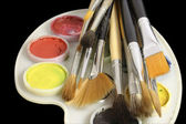 Set of art brushes and water colour — Stock Photo
