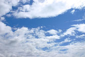 The blue sky with fluffy clouds — Stock Photo