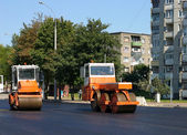Lorries loaded by hot asphalt — Stock Photo
