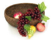 Round basket from rattan with fruits — Stock Photo