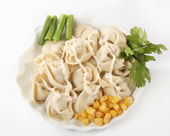 Pelmeni on a plate — Stockfoto
