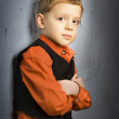 Stock Photo: Boy standing near wall