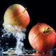 Apples in water — Stock fotografie