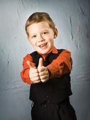 Boy making thumbs up sign — Stok fotoğraf