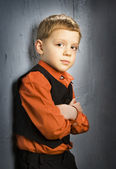 Boy standing near the wall — Stock Photo