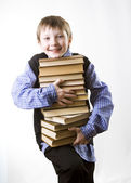 Boy with a Stack of books — Stock Photo
