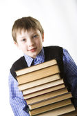 Boy with a Stack of books — Stockfoto
