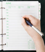 Hand Writing in to Personal Organizer — Stock Photo