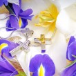 Stock Photo: White lily with gold jewelry