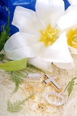 White lily with gold jewelry — Stock Photo