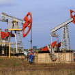 Стоковое фото: Two Oil pumps extract oil