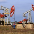 Stock Photo: Two Oil pumps extract oil