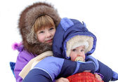 Small children are very glad to winter — Stock Photo
