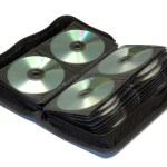 Сумка для хранения CD и DVD дисков, изолированная на белом фоне.