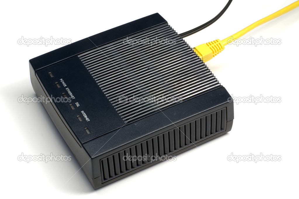 Black ADSL modem with connected LAN and phone wires — Stock Photo #1470179
