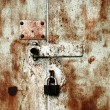 Old rusty lock on the door — Stock Photo #1624450