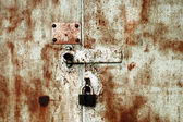 Old rusty lock on the door — Stock Photo