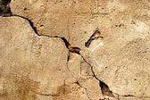ひびの入ったグランジ石セメント背景 — ストック写真