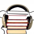 Stock Photo: Old style headphones and books