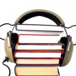 图库照片: Old style headphones and books