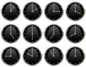 Collection of clocks ticking all hours — Stock Photo