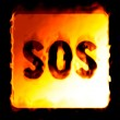 SOS background in flames on a black back — Stock Photo