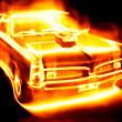 Car surrounded by flames on a black back — Stock Photo