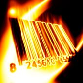 Barcode surrounded by fire on a black ba — Stock Photo