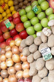 Fruit laid out on sale with price lists — Stock Photo