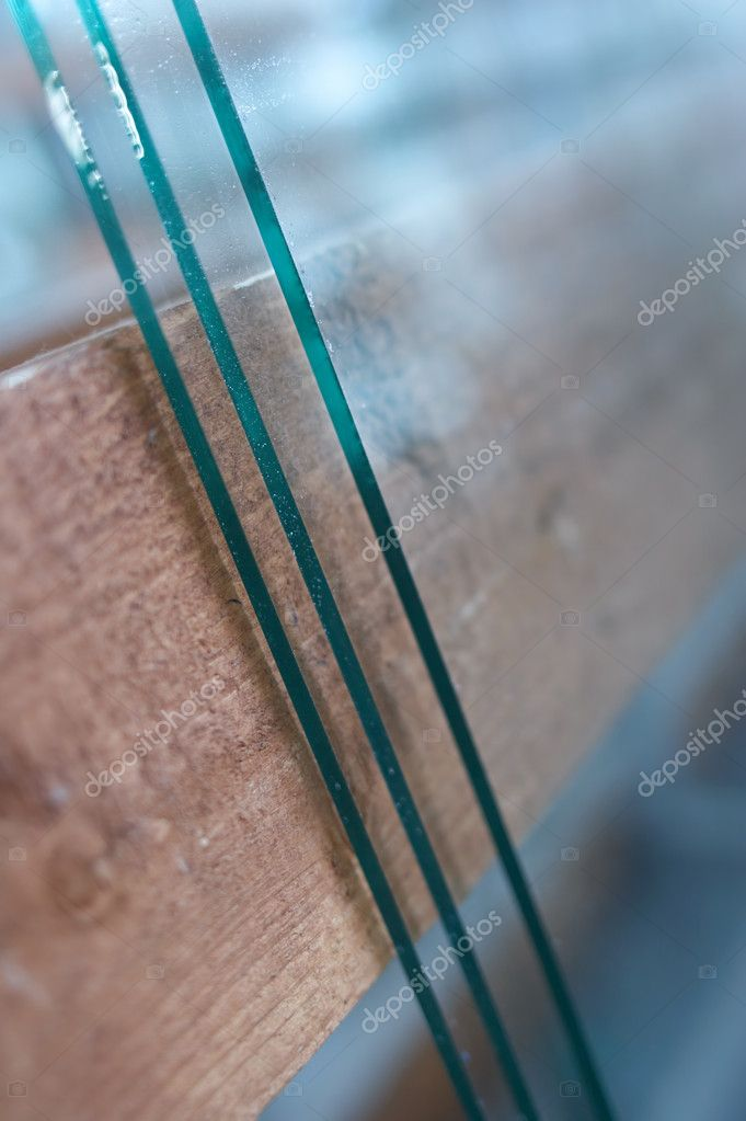 By manufacture of windows on technology of glass lay on racks — Stock Photo #1493962