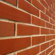 Red Bricked Wall In Perspective — Zdjęcie stockowe