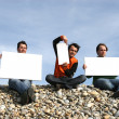 Men Holding White Card at the beach — Stock Photo #1483030