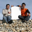Stock fotografie: Men Holding White Card at the beach