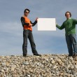 Stockfoto: Men holding a blank white card