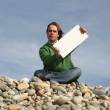 Man Holding White Card at the beach — Stock Photo