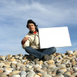 Man Holding White Card at the beach — Stock Photo #1483264