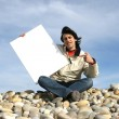 Man Holding White Card at the beach — Stock Photo #1483268